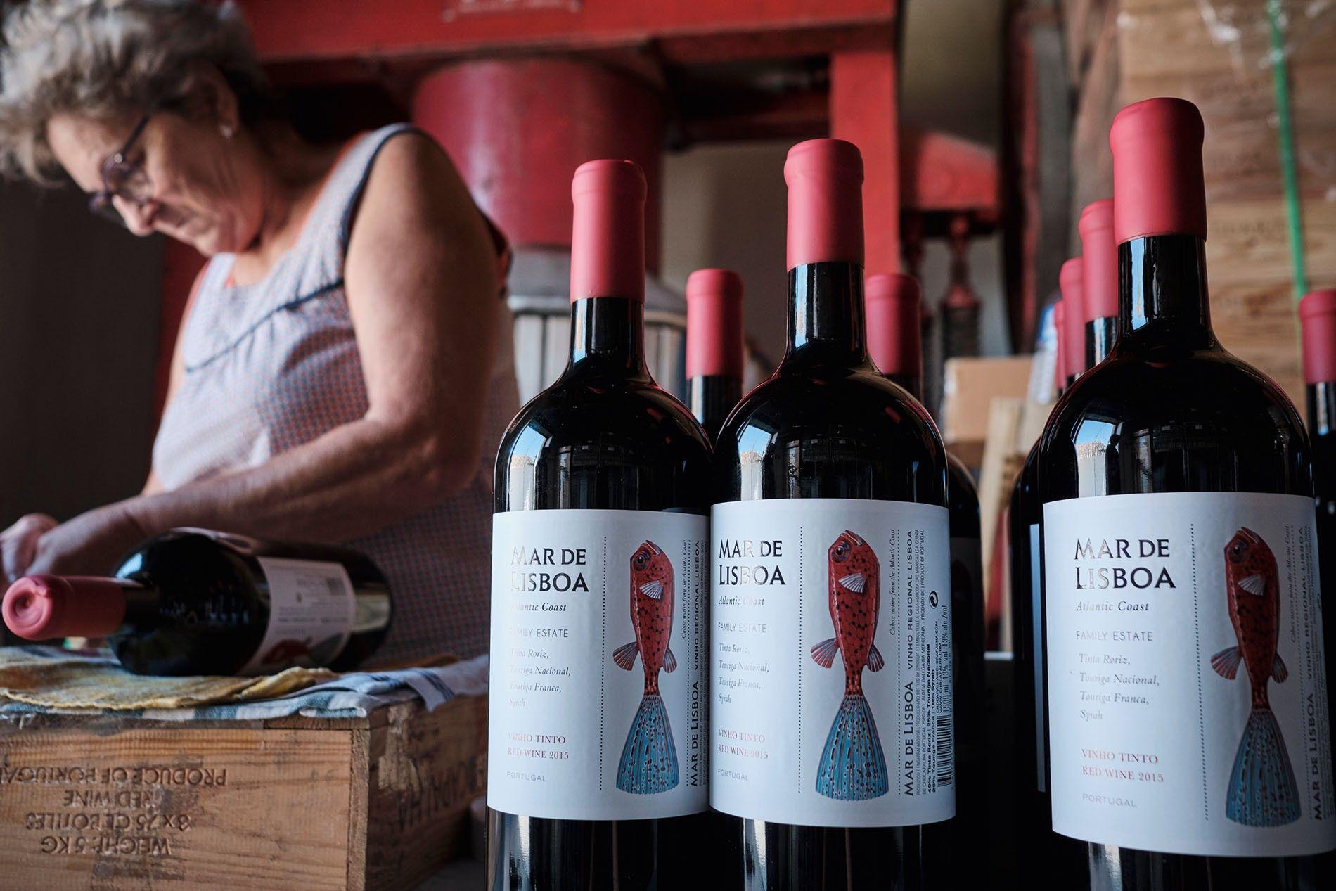 Helena Rodrigues labels bottles of the 2015 Mar de Lisboa, a red blend from Quinta de ...