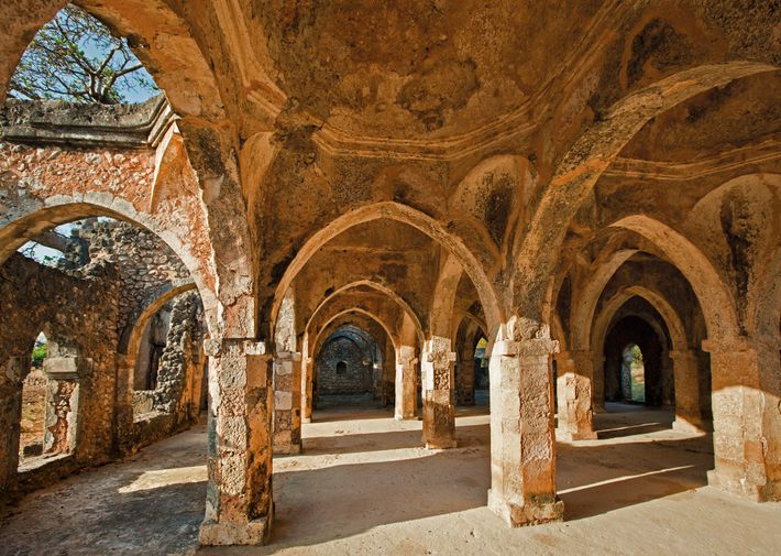 The prayer room in the Kilwa Great Mosque is built partly from coral stone. Begun in ...