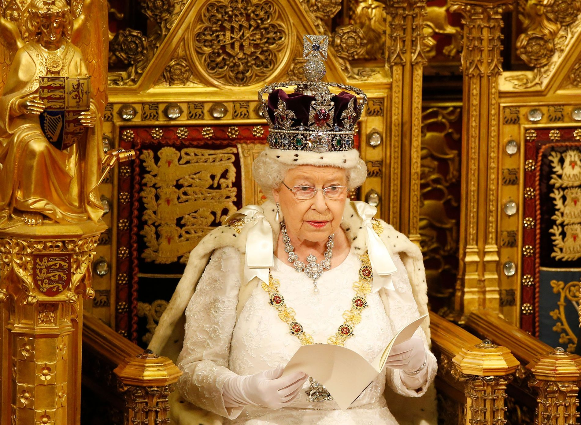 Queen Elizabeth II reads a speech in the House of Lords to formally start a parliamentary ...