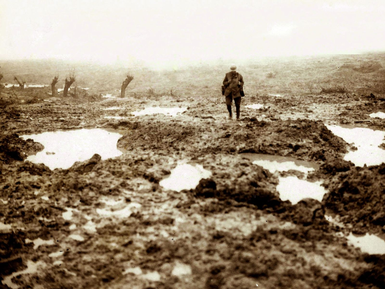 A Canadian soldier surveys the aftermath of the 1917 Battle of Passchendaele in Belgium. Hundreds of ...