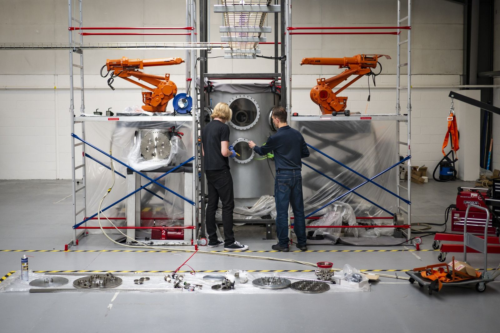 Richard Dinan and James Lambert working on the Pulsar Fusion reactor, July 2019.