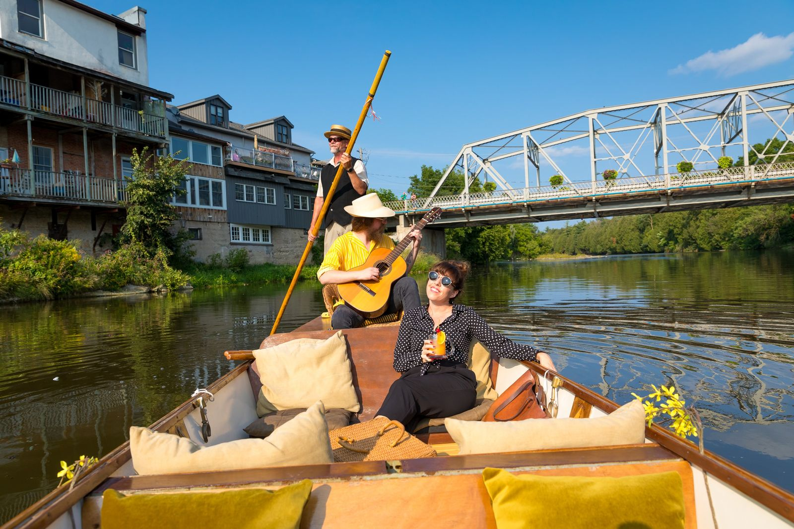 Rachel Ryle cruises the Grand River in a custom built and locally fabricated watercraft Punt Boat ...
