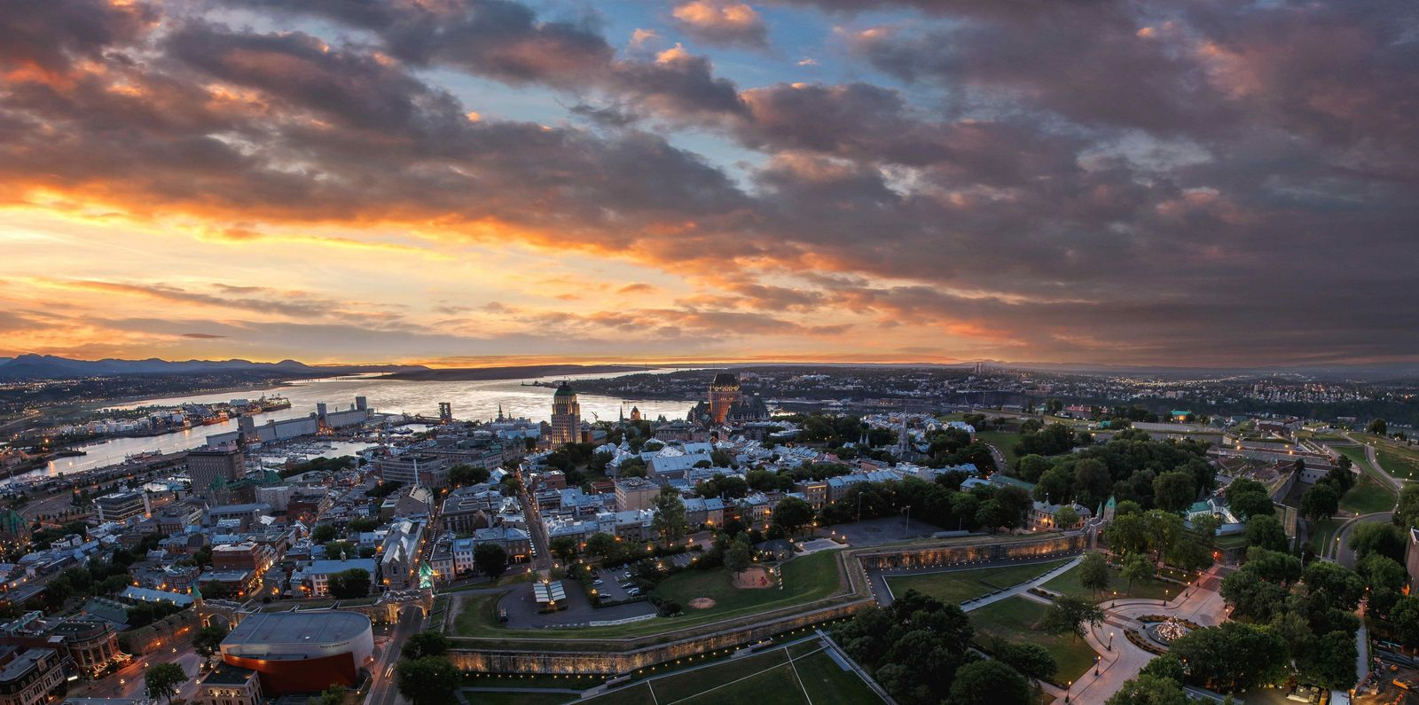 View of Québec City and the St. Lawrence River at sunset.
