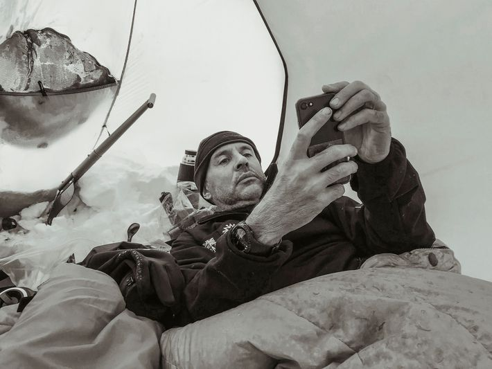Rudd rests inside his tent. Due to the 24-hour sun in Antarctica this time of year, ...
