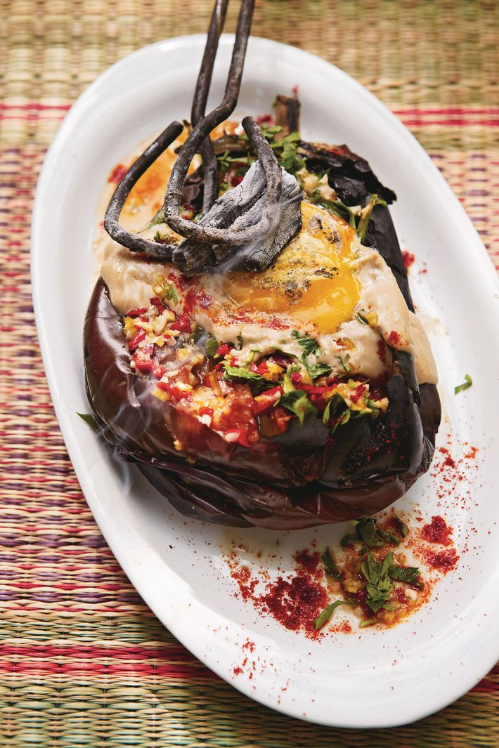 Whole burnt aubergine with charred egg yolk, tahini & chilli sauce by Sarit Packer & Itamar Srulovich