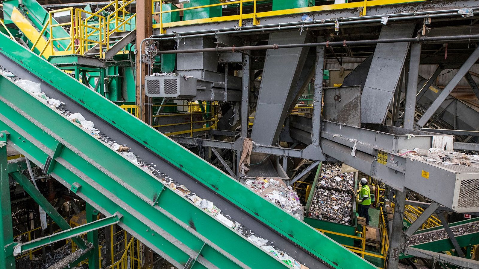 Mixed plastics are conveyed toward an optical sorter at a recycling plant. The industry is going ...