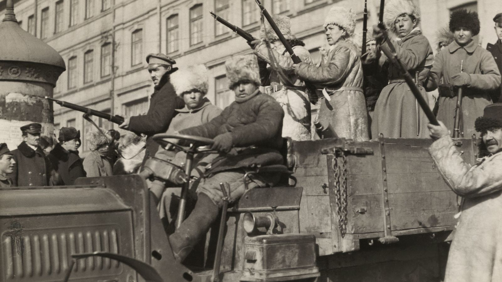 Bolsheviks armed with guns ride in a truck in Vladivostok, Russia, in 1920. Led by Vladimir ...