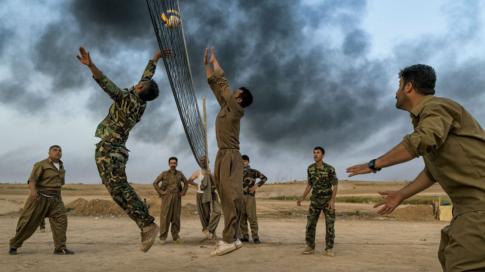 Kurdish troops known as peshmerga play volleyball near Kirkuk. Kurdish forces fought against the Islamic State ...