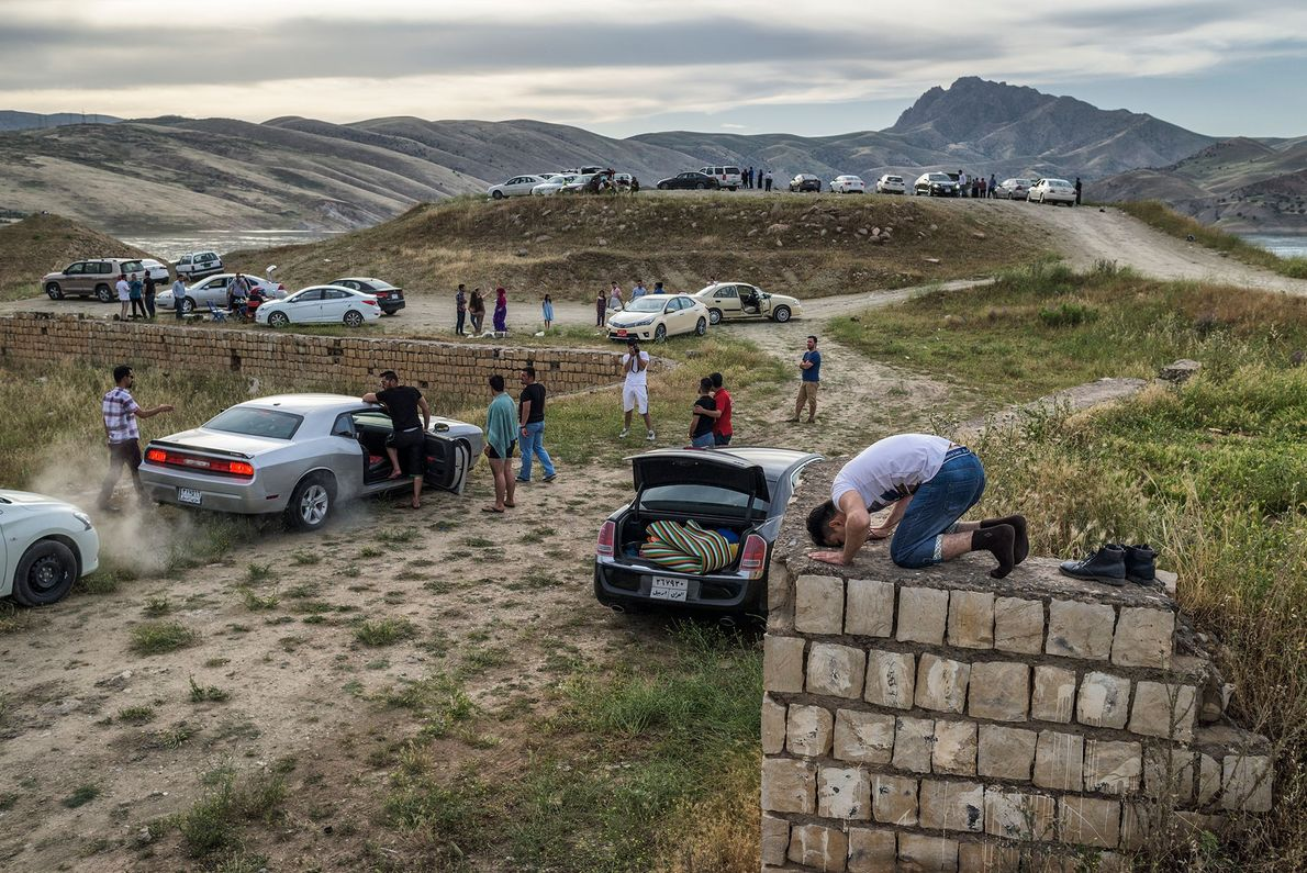 Kurdish families picnic less than three hours away from battle lines drawn in northern Iraq, while ...
