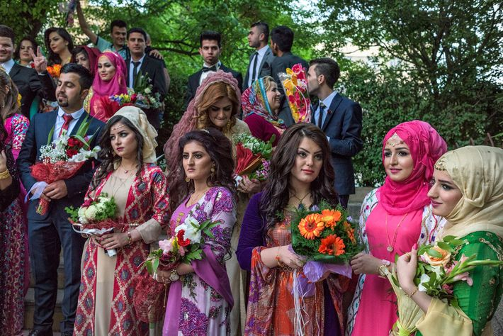 Young Kurds wear a mix of traditional and Western clothing to a graduation at the University ...