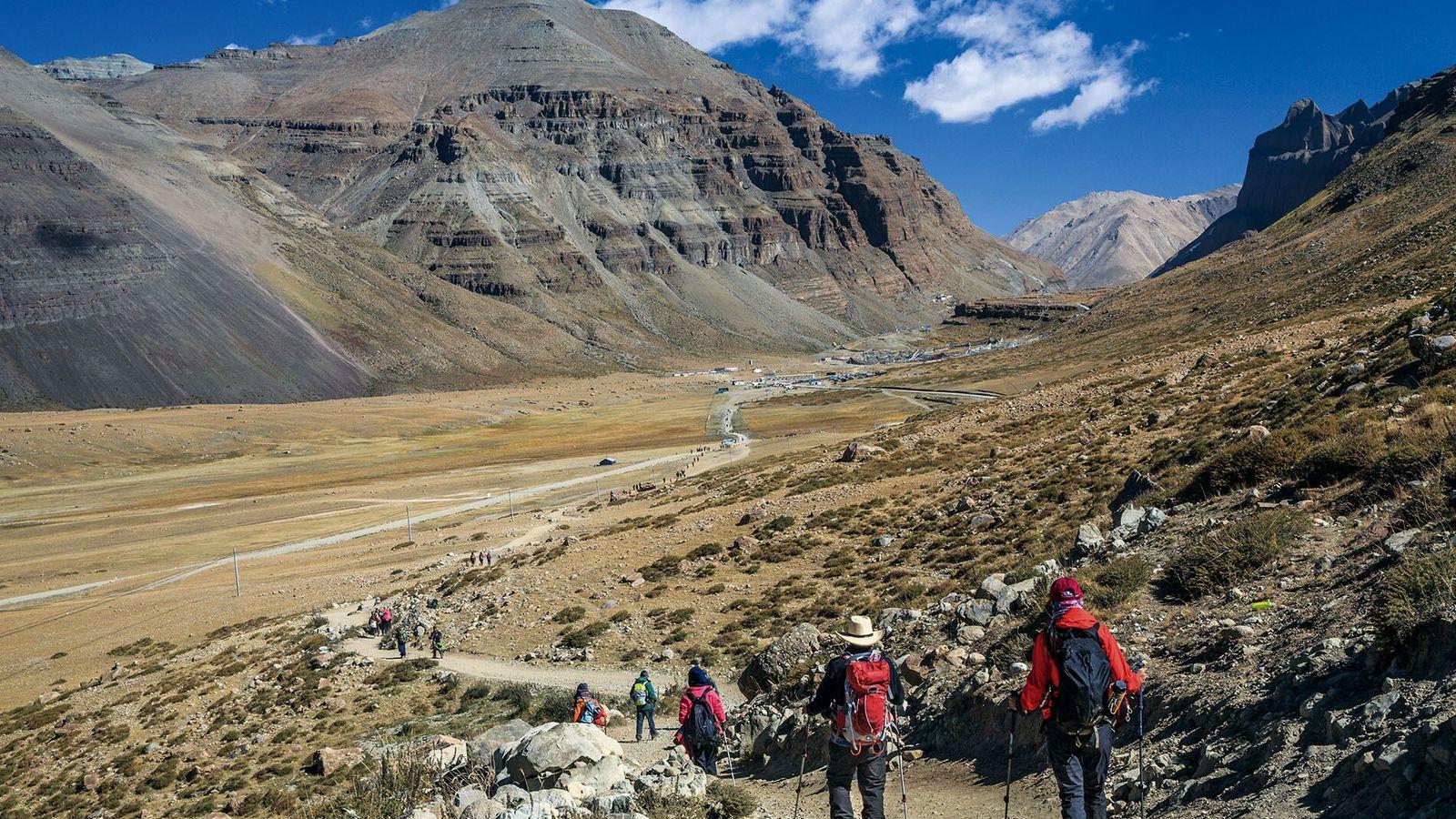 Hikers in the Tibet Autonomous Region on a kora (a type of pilgrimage), circumambulating Mount Kailash, ...