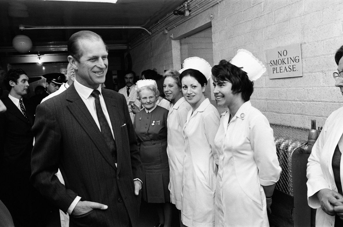 Philip greets staff at the Birmingham General Hospital while visiting victims of the Birmingham pub bombings ...