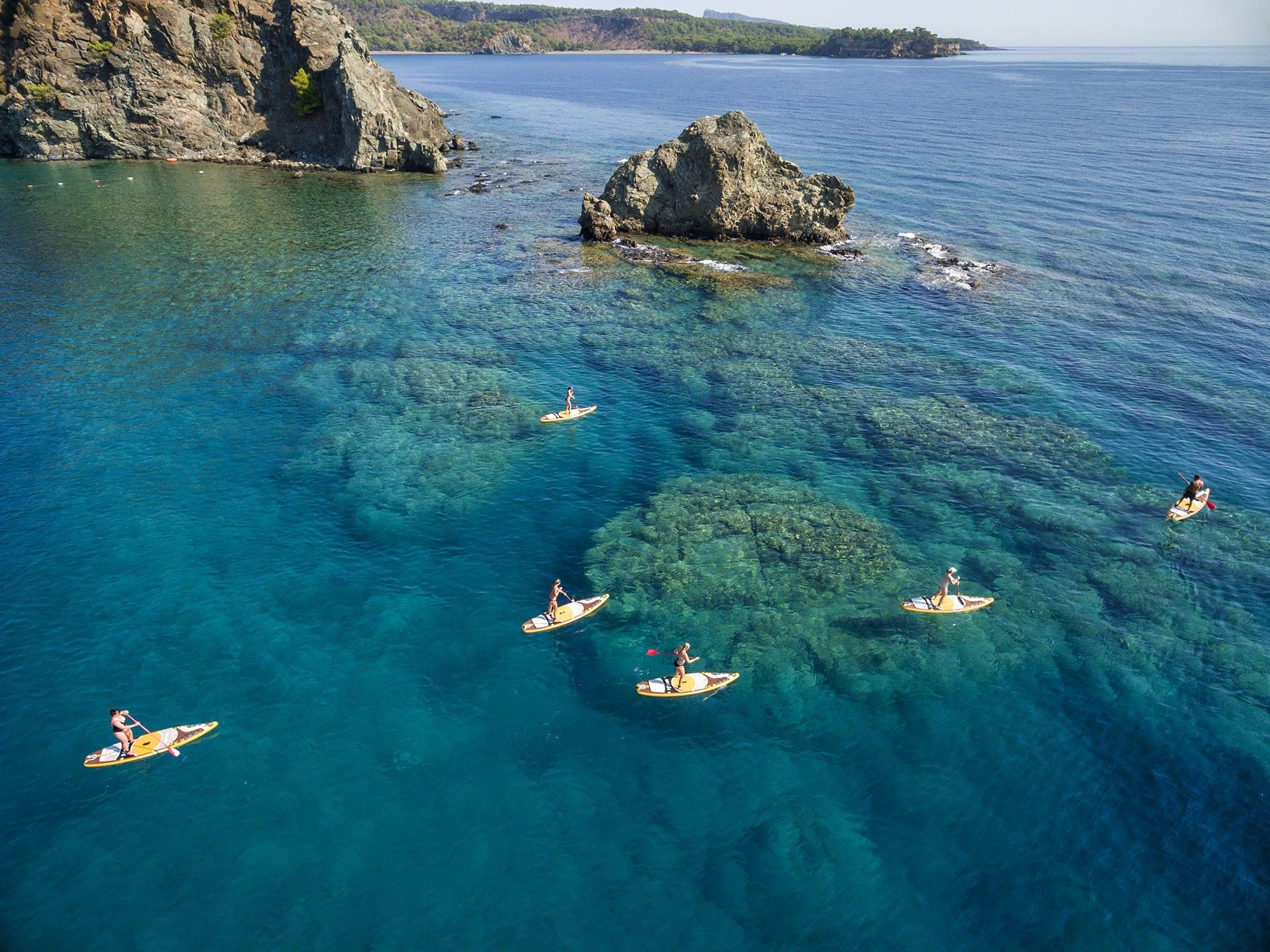 Stand up paddleboarding is a popular pastime in the Mediterranean off the coast of Turkey.