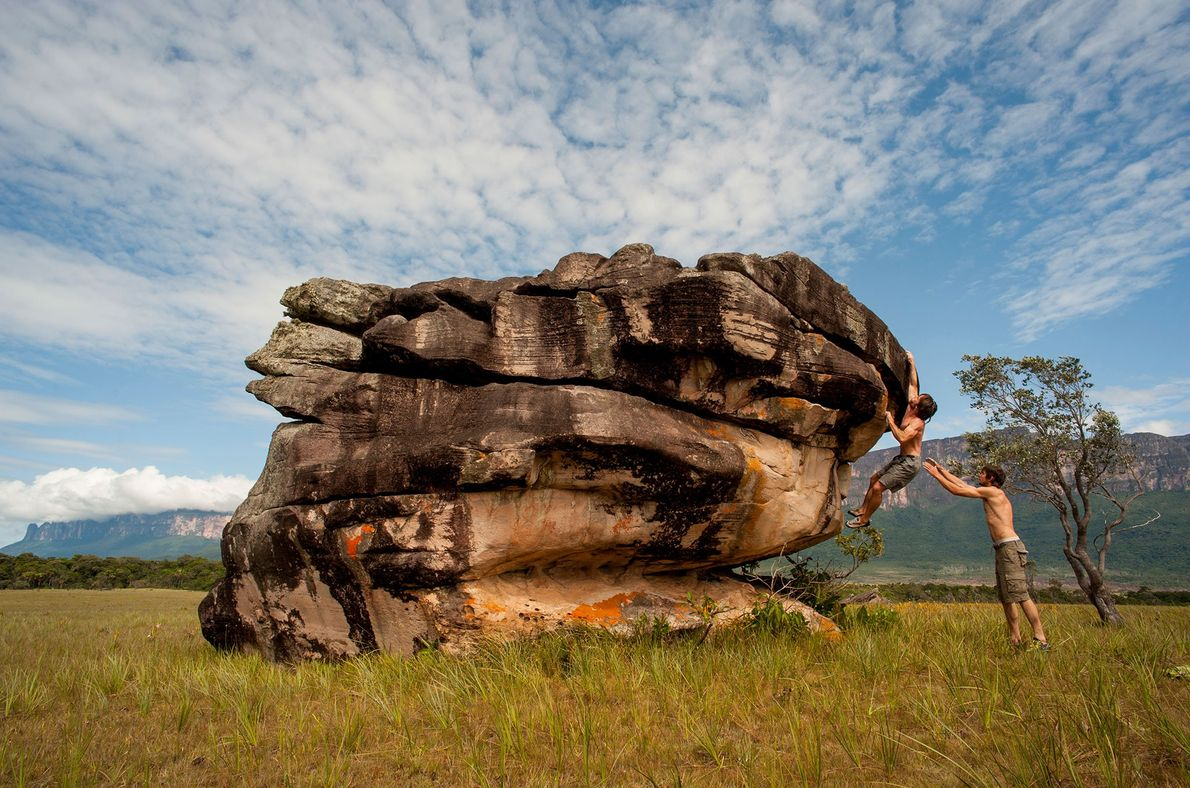 Bouldering focusses on mastering the athleticism of climbing. At this boulder in Venezuela, a man helps ...