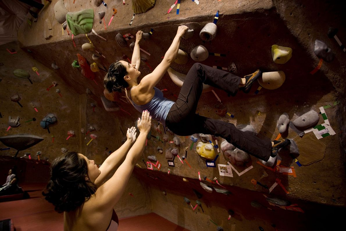 Climbers at the Stone Gardens climbing gym in Seattle. The burgeoning indoor gym industry is introducing ...