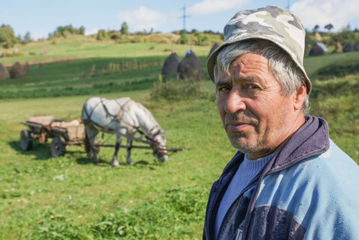Farmer on a hillside just outside of Breb, Romania. Image: Henry Wismayer