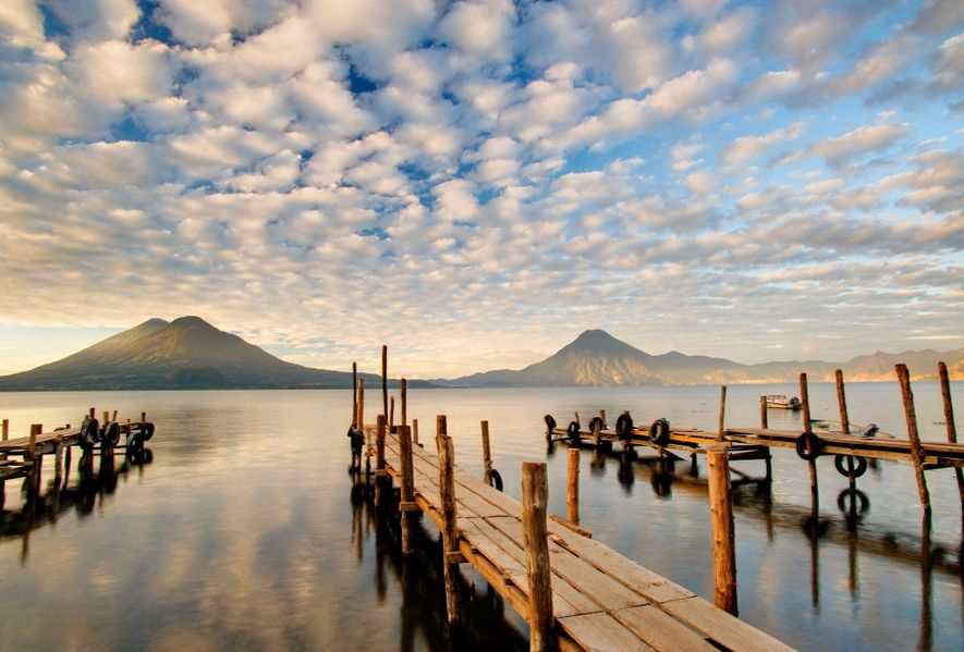 Wooden docks protrude out into Lake Atitlán in Guatemala.