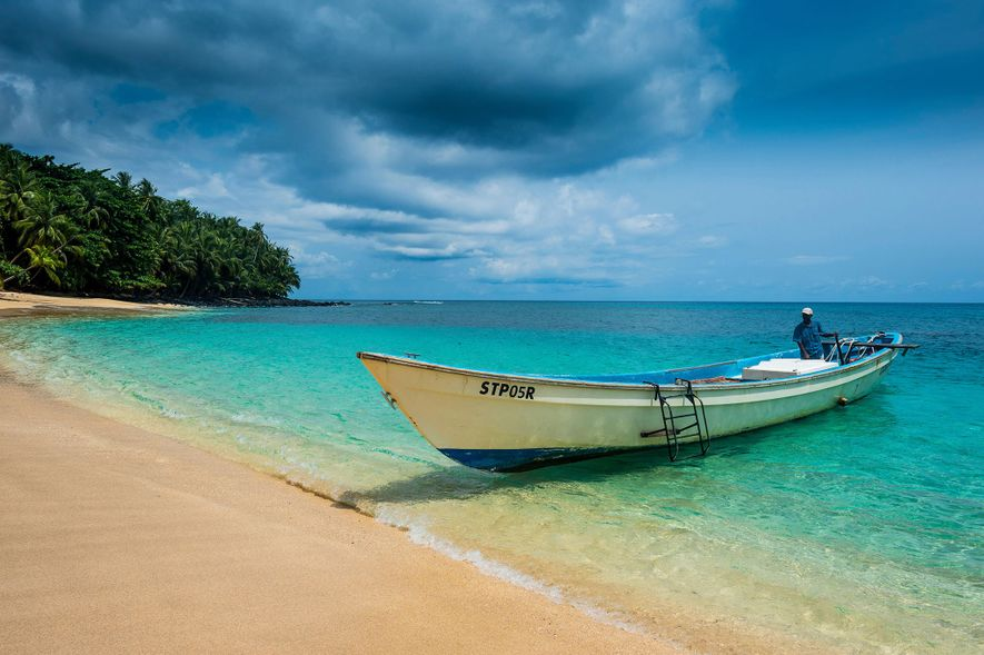 A boat pulls up to the sandy shore of Banana Beach in São Tomé and Princípe.