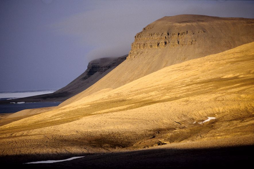 Cliffs rise near the coast of Canada's Somerset Island inside the Arctic Circle.