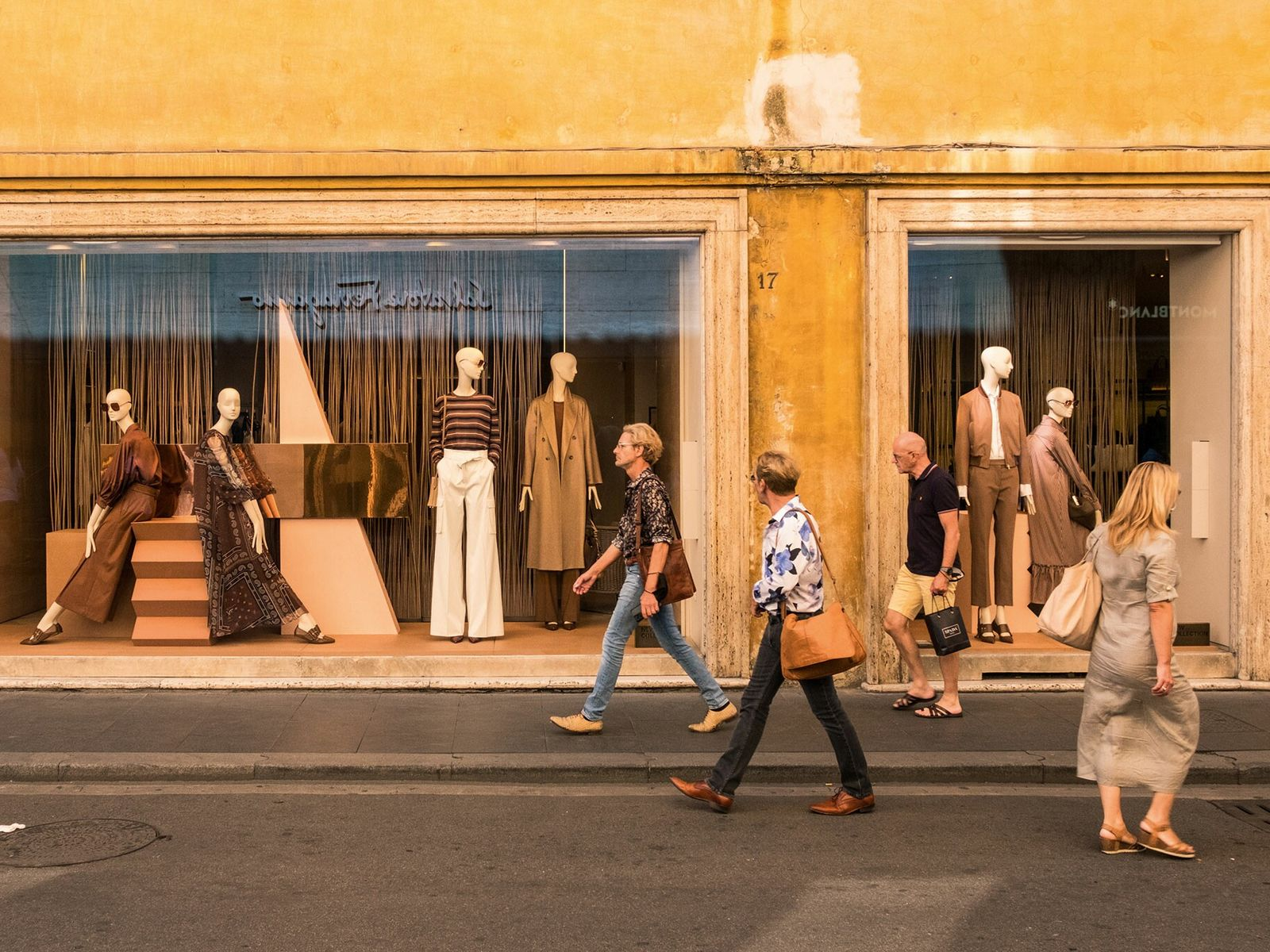 Shoppers browse the boutiques on Via Condotti in the district of Monti.