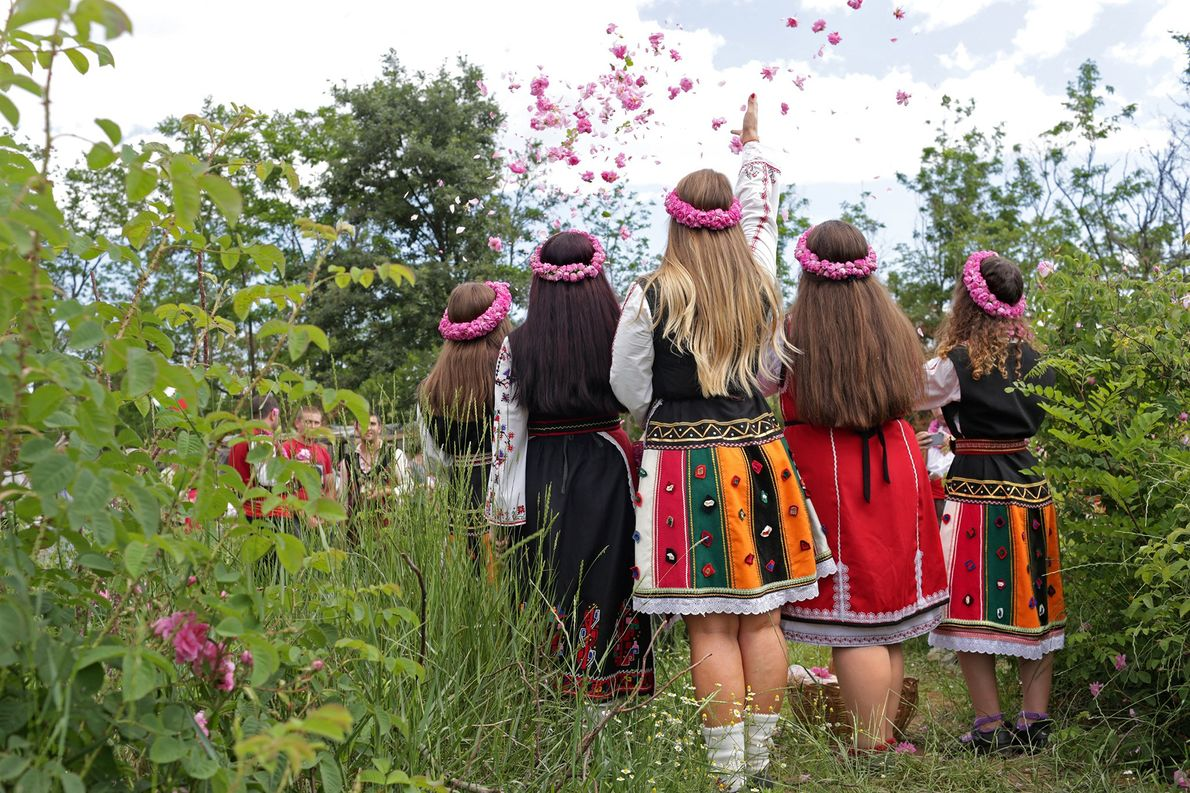 Women wearing traditional Bulgarian folk garb pose for pictures of themselves near Buzovgrad, Bulgaria.