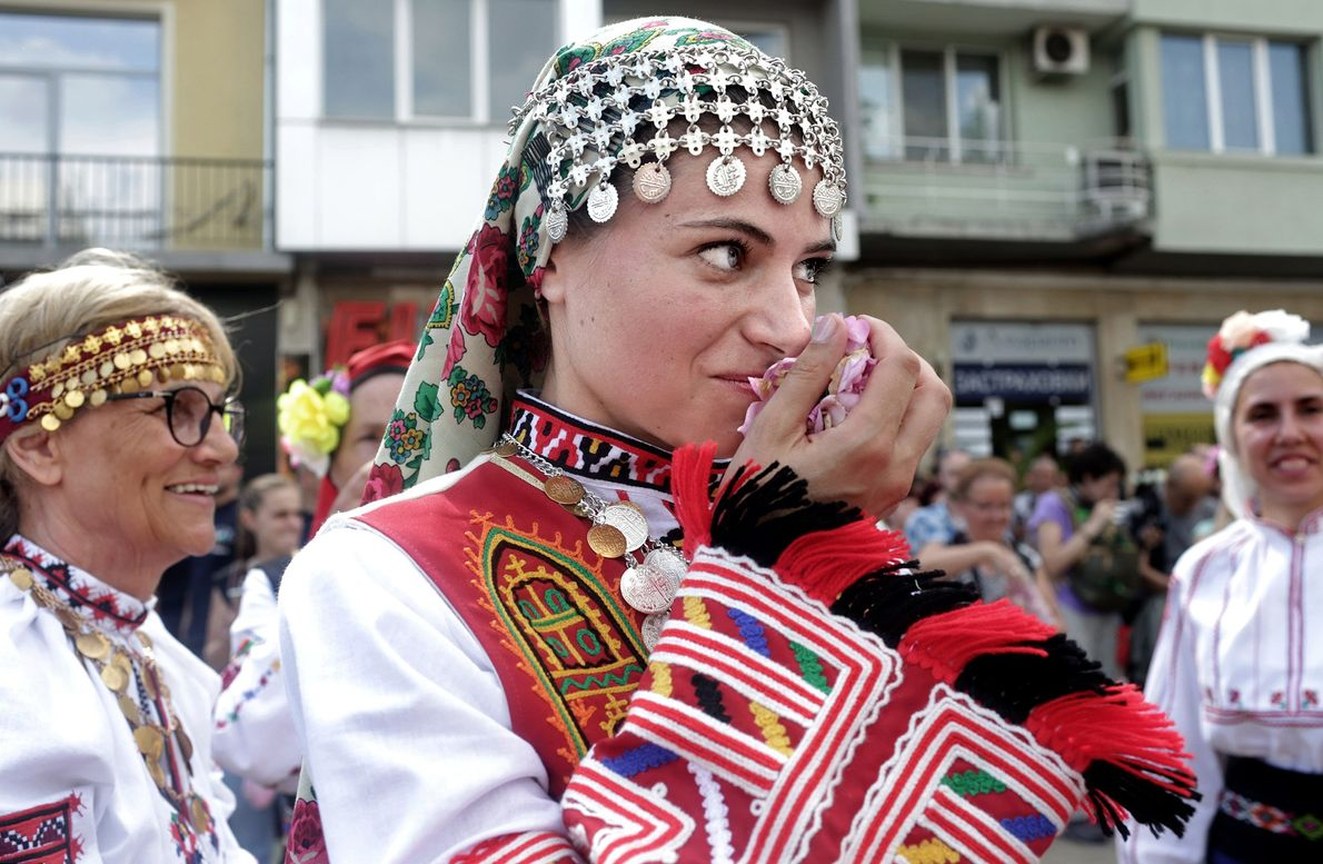 The folk dance ensemble called Bis from Sofia takes a break after performing.