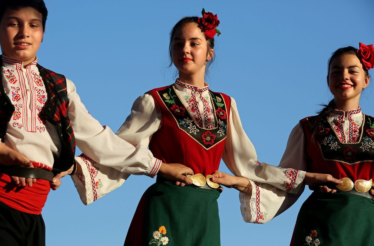 Members of the dance ensemble Zhar, from Kazanlak, perform on stage at the festival in Kazanlak.