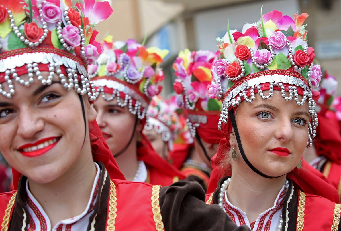 Members of the folk ensemble Kocani, from Kocani, Macedonia, prepare to perform on stage during the ...