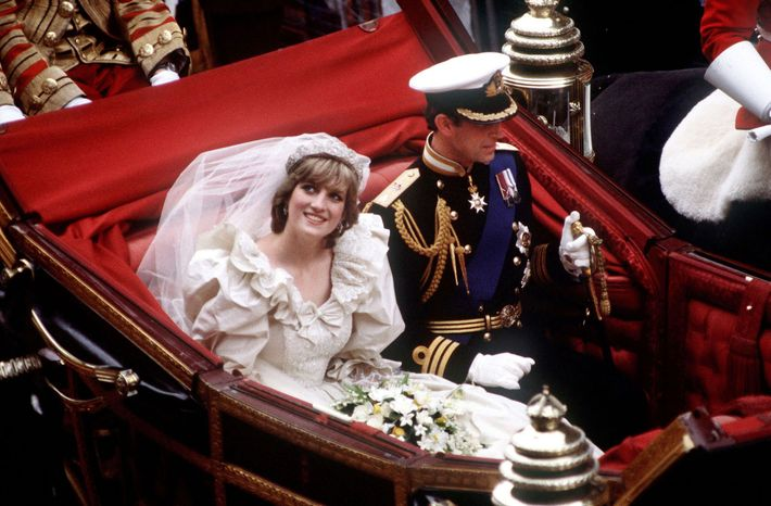 The Prince and Princess of Wales return to Buckingham Palace by carriage after their wedding, 29th ...