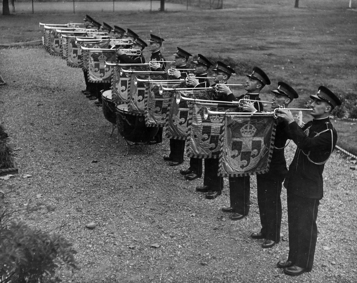 The royal fanfare, played by the State Trumpeters on instruments bearing a royal coat of arms, …