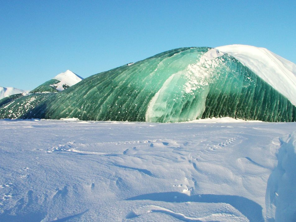 Icebergs can be emerald green. Now we know why.