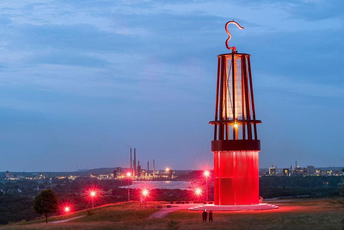 """In Moers, artist Otto Piene's sculpture """"Geleucht"""" is modeled on a miner's lamp and sits atop ..."""