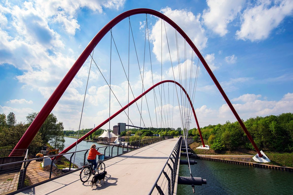 Locals enjoy biking or walking along and across the Rhine-Herne Canal, which once served to transport ...