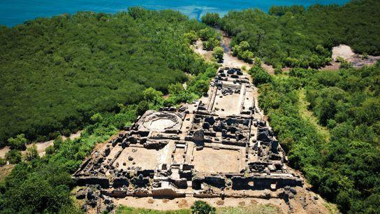 The ruins of the Husuni Kubwa, the palace-fort of Kilwa, Tanzania, overlook the Indian Ocean. The ...