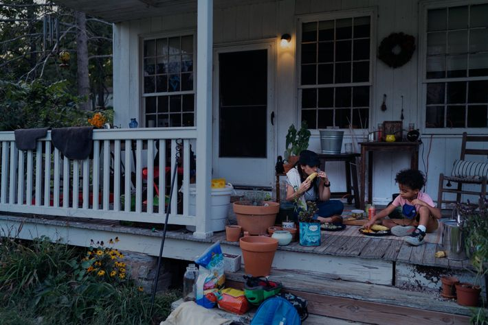 Hermelinda and Santos eat dinner on their porch in Virginia. Cortés returned home to Virginia in ...