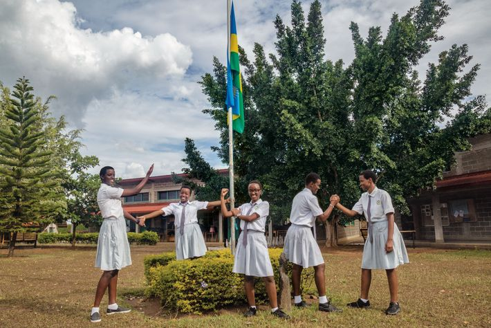 Cynthia Ikirezi (centre) beams with her fellow prefects, student leaders, at Gashora Girls Academy in Rwanda. ...
