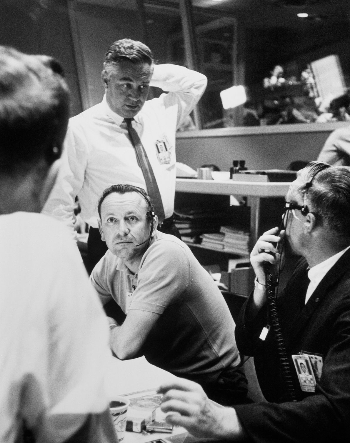 Officials in the Mercury Control Centre make the decision to go for 22 orbits during the ...