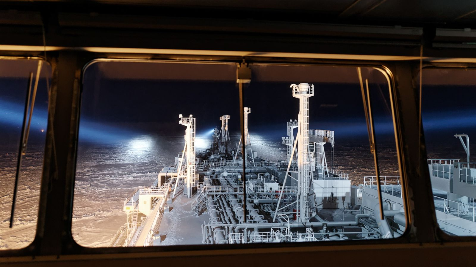 At night in the Kara Sea, powerful searchlights illuminate the ice ahead for the officers on ...