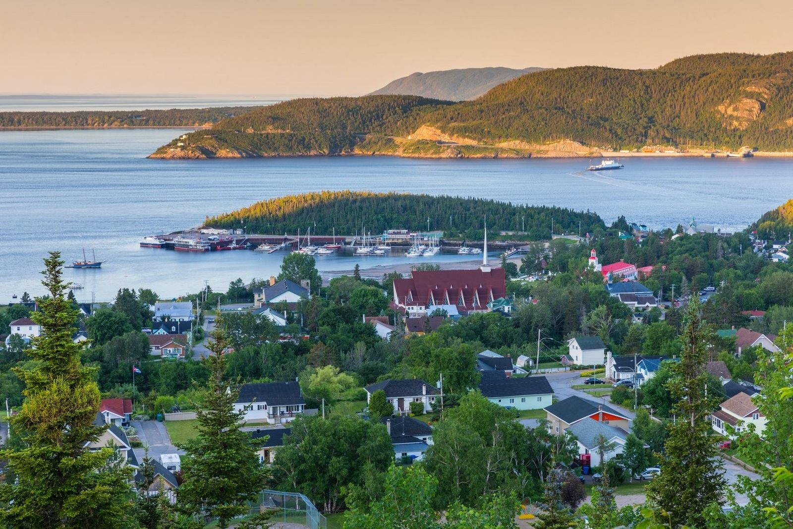 View of the charming town of Tadoussac located on the northwest shore of the Saint Lawrence ...