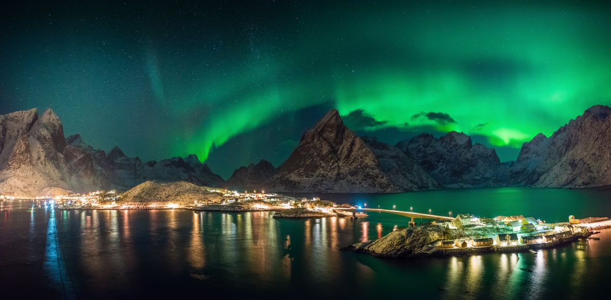 The Lofoten archipelago: Kjerkfjorden and Sakrisøy, under the glow of the northern lights.