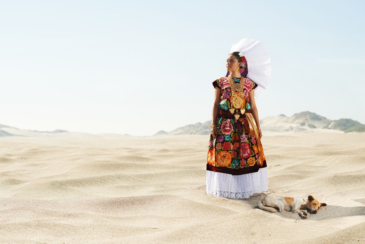 An Isthmian woman wears a traditional dress that once belonged to her grandmother. Families pass down ...