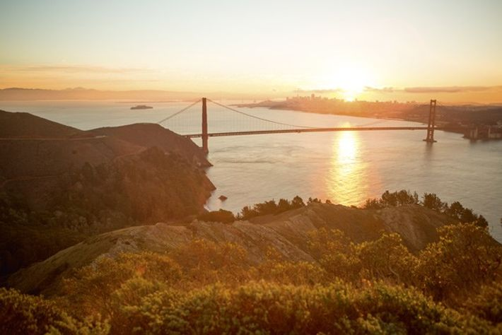 The Golden Gate Bridge at sunrise as seen from the Marin Headlands.