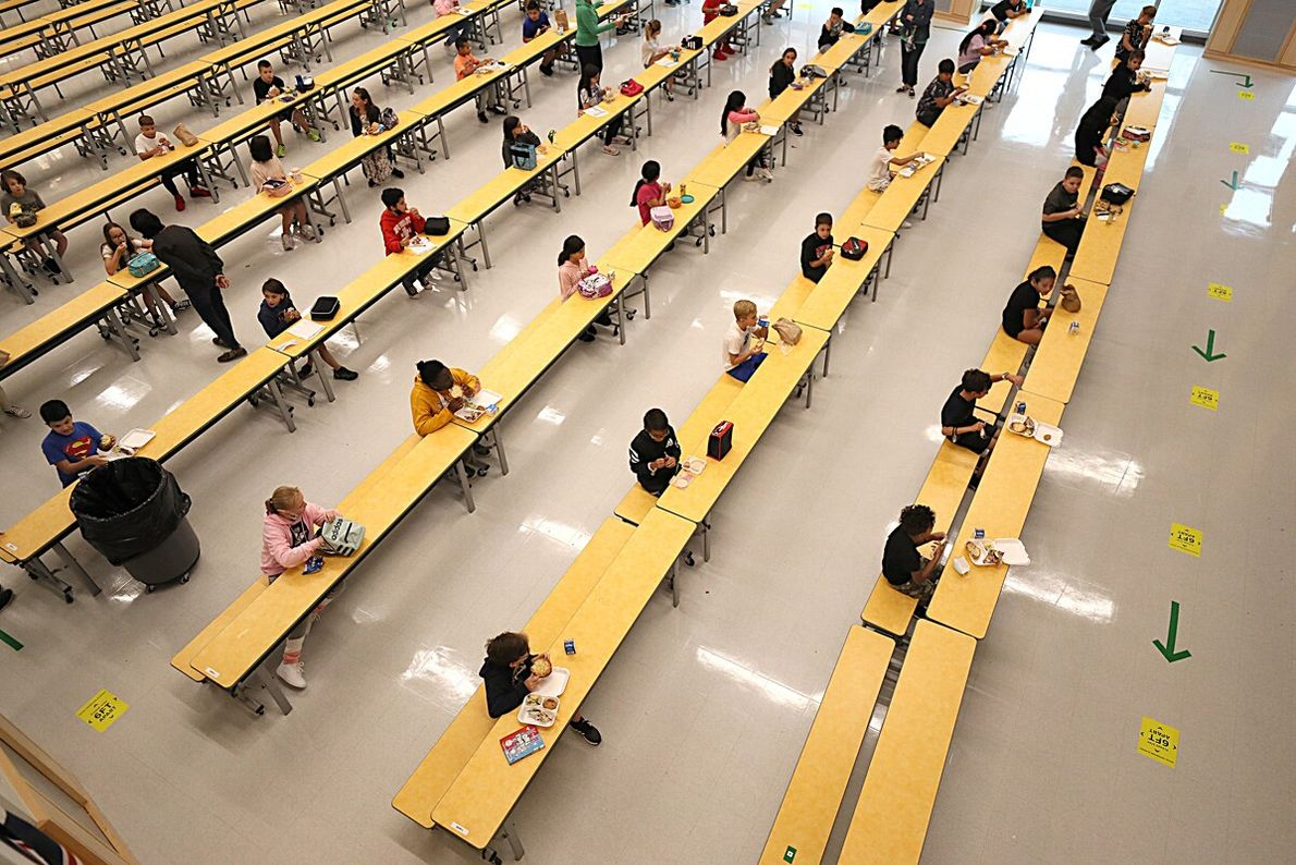 Children have a socially distanced lunch at Woodland Elementary School in Milford, Massachusetts, on September 11.