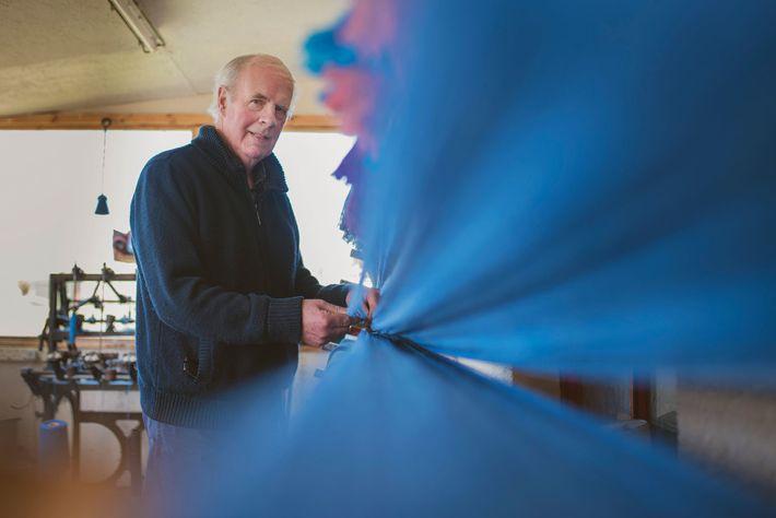 Weaver Norman Mackenzie at his loom shed in Carloway in Lewis.