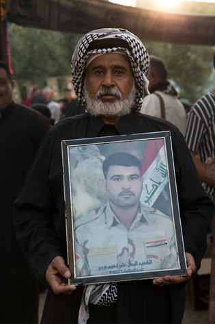 Naim (60), walks to Karbala with a picture of his son Amer, killed by ISIS in ...