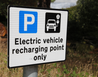A sign for an EV recharging point in the New Forest, Hampshire. As the government strives ...