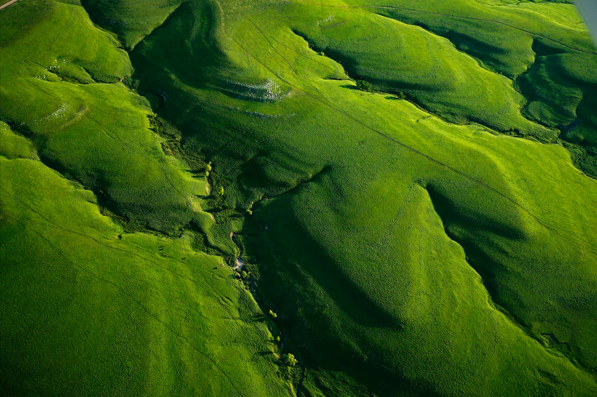 An aerial view shows the lushness of the Flint Hills in Kansas, one of the last ...