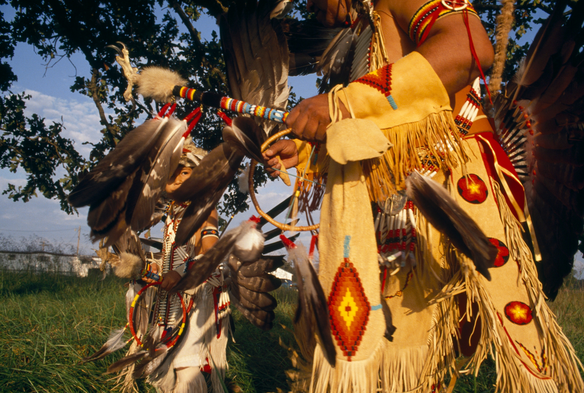 In Stillwell, Oklahoma, a grandfather teaches a Cherokee dance to his grandson. A story in the ...