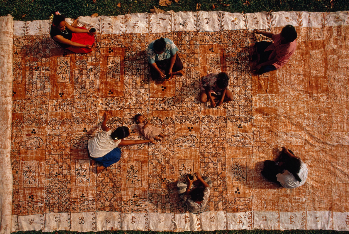 On the island of Tonga, women ink intricate designs onto a tapa cloth in honour of ...