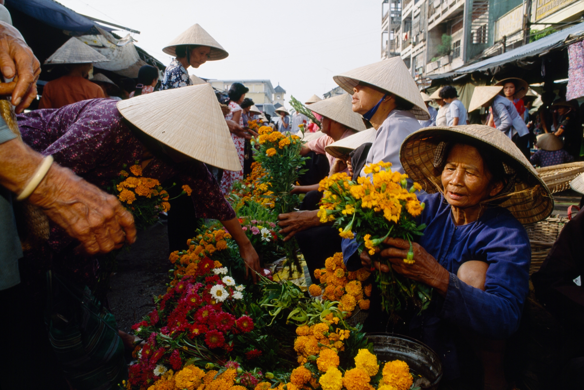 In Can Tho, Vietnam, flower merchants sell marigolds on the street. A February 1993 story travelled ...